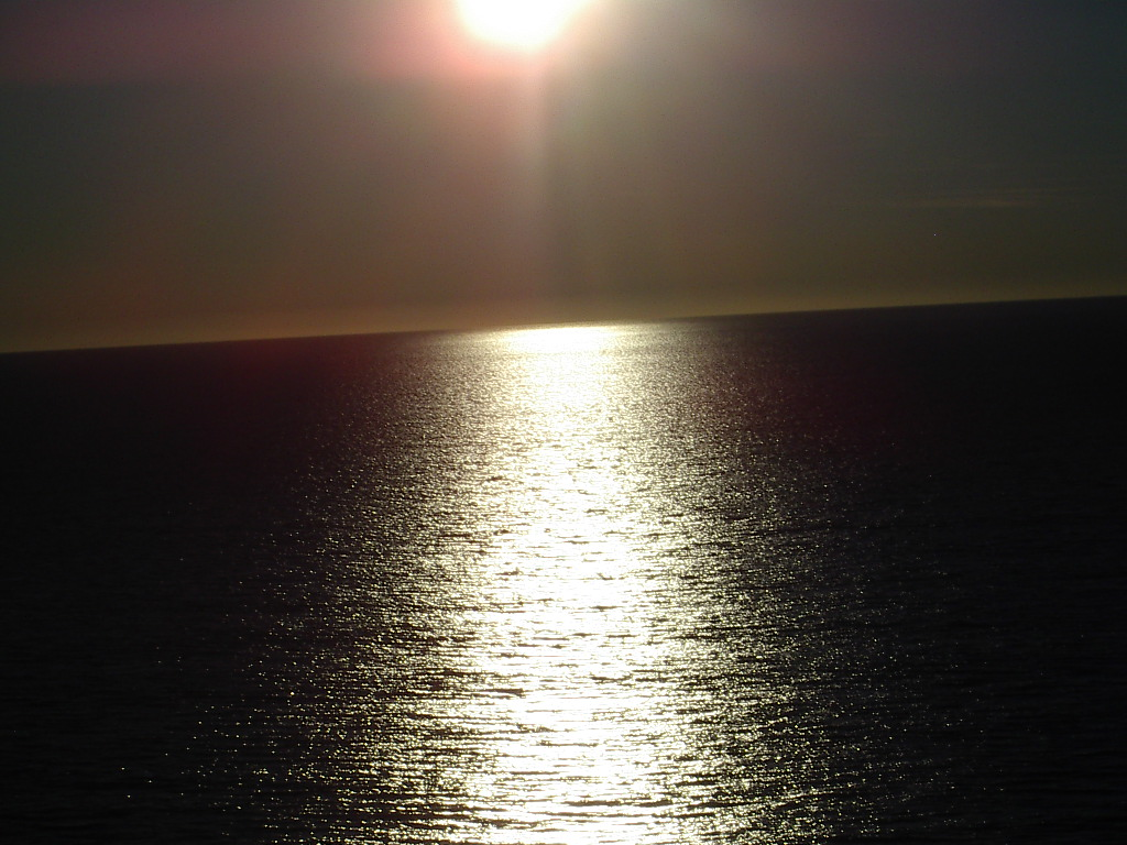 Image of a Candle Shore sunset on the ocean.